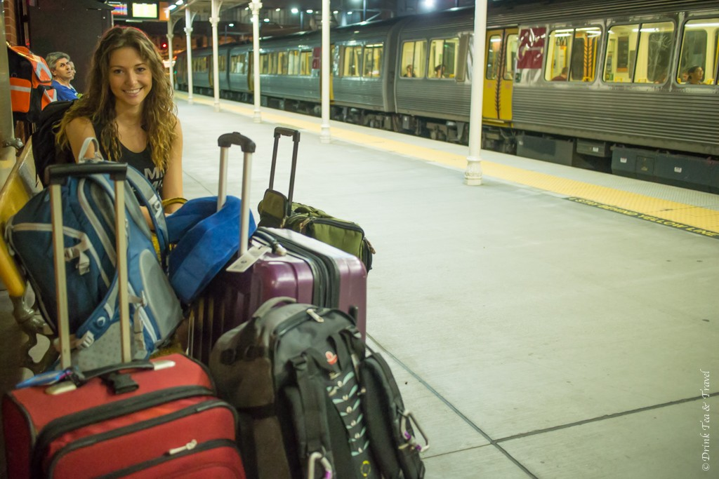 Oksana with bags at train station. Gold Coast. Queensland. Australia