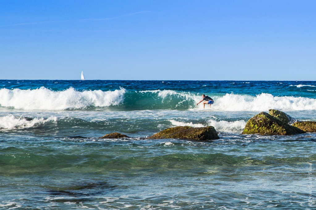 A surfer riding a wave at Coolangatta Beach, Gold Coast, Australia