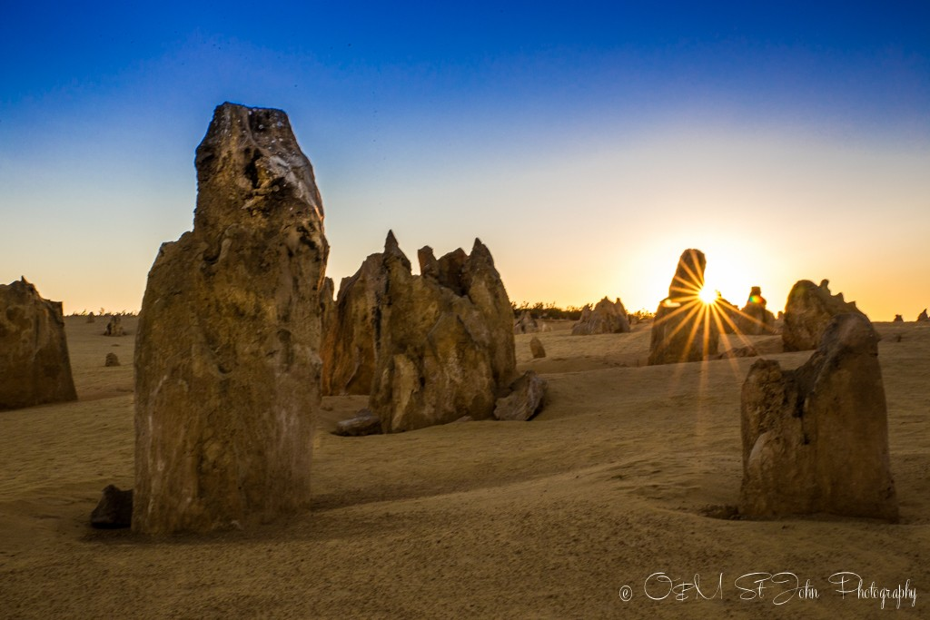 Sun peaking out from one of the pinnacles at the Pinnacles Desert in Cervantes. Western Australia