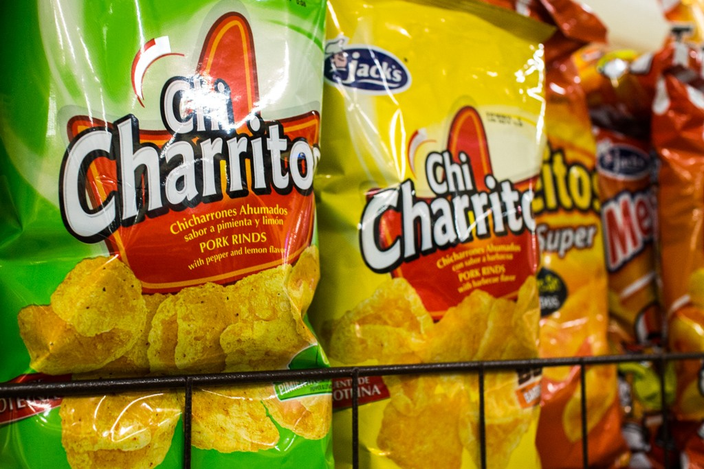 Costa Rican Supermarket Finds: Chicharritos, smocked pork rinds, are one of the locals' favourite snacks. They come in a variety of flavours similar to North American chips.