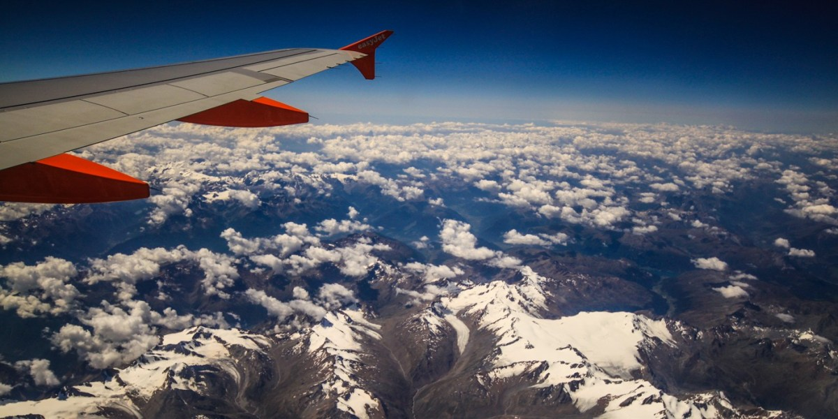 Flight over Swiss Alps. Europe . How to find cheap flights.