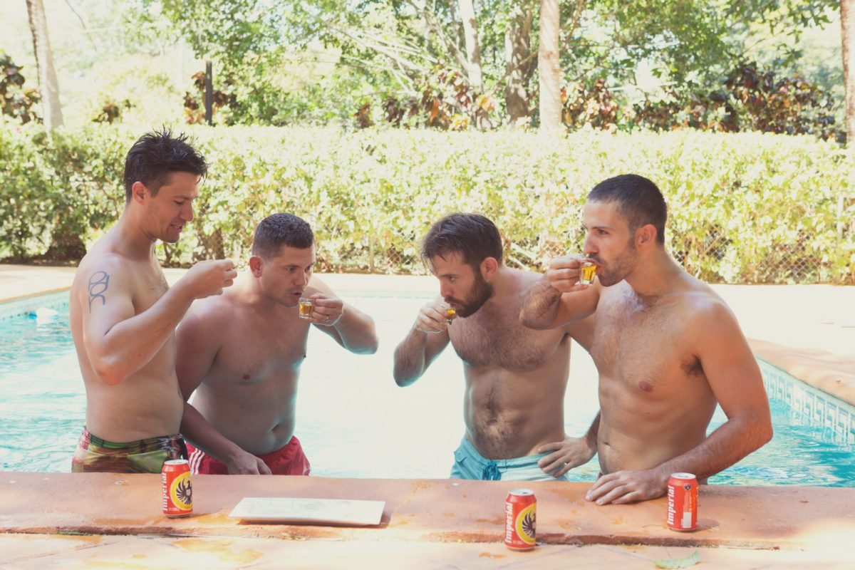 Max and his groomsmen taking shots in the pool. Wedding. Costa Rica