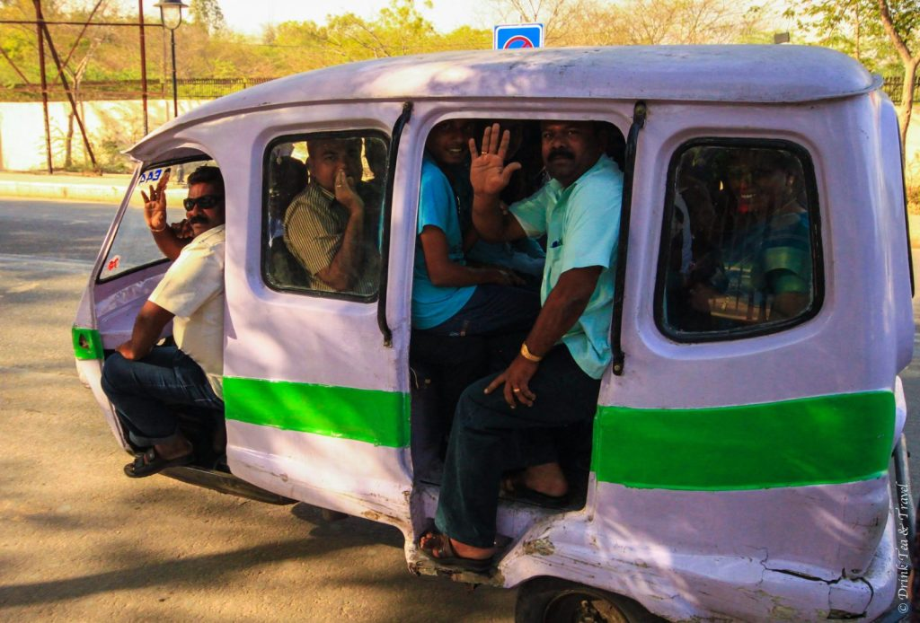 Van packed with too many people in India