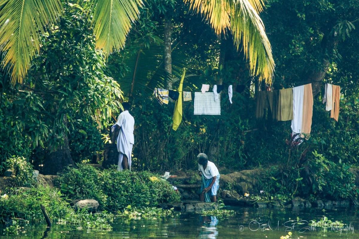 Woman doing laundry in Kerala Backwaters. India