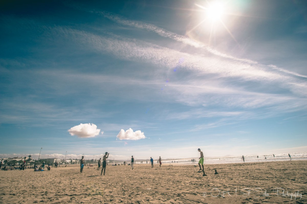 Locals playing football on Plage Tagharte. Essaouira. Morocco