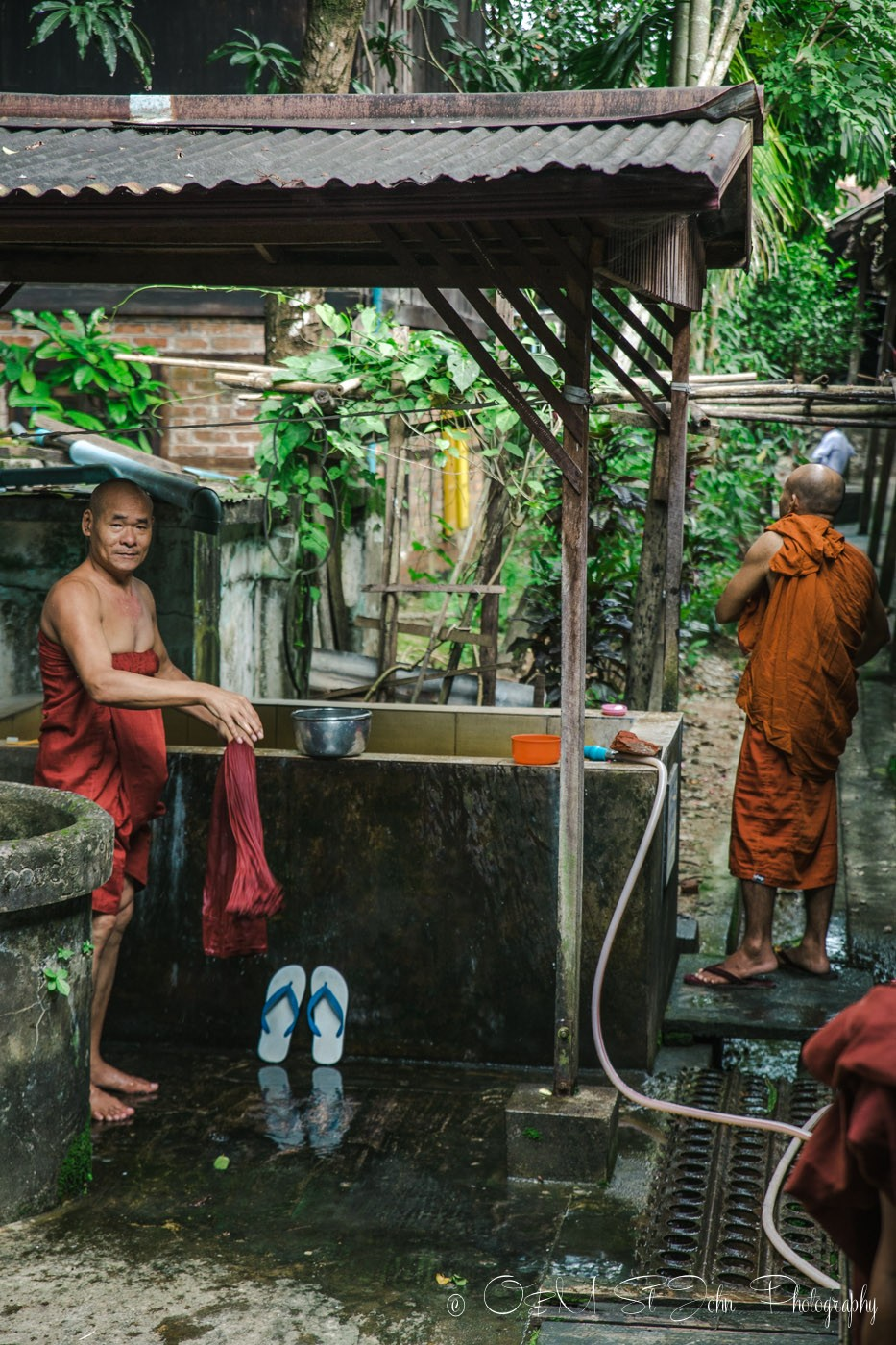 Monks showering at the monastery. Yangon, Myanmar