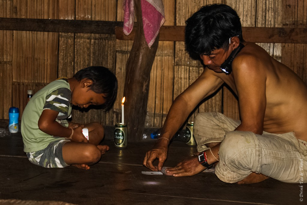 Father and son enjoying a game of cards