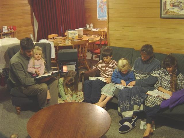 Our picture shows one of our families having a reading from the Bible while breakfast waits for them on the table.