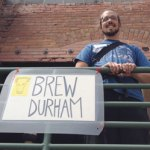 Keil Jansen, founder of Brew Durham, smiles at the entrance to the event.