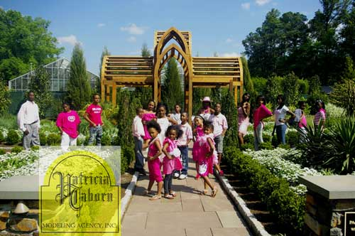 "Some of the Patricia Taborn youth at a ""Passionate about Pink"" photo shoot at Duke Gardens in Durham. The shoot taught the children to be passionate about their life goals. (Photo courtesy of Cozy Creations and Patricia Taborn Modeling Agency)"