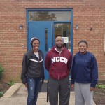 Kiera Jacobs (far left) and Adrianna Poole (far right) with John Avery Boys and Girls Club women's basketball coach Dexter Jenkins. Jacobs and Poole played for the club's team this past summer and attend Riverside High School in Durham, where they both play on the varsity team.