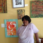 Carmen O'Neal poses with Lilly's newest artwork.