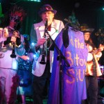Blaise Kielar, music director of the Bulltown Strutters, gets passionate as he helps the band play Mardi Gras classics like When The Saints Go Marching In. (Staff photo by Zoe Schafer)