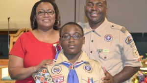 Proud parents Anthony and Sophia Perry commend their son, Joshua Perry, on becoming an Eagle Scout in August.