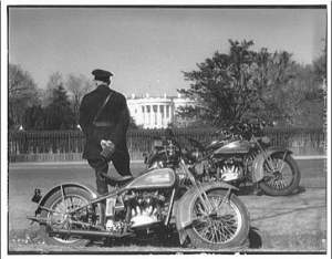 Police guard with motorcycle, White House in rear