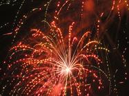 red fireworks against black sky