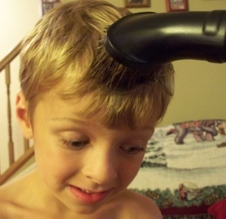Removing sand from hair by vacuuming