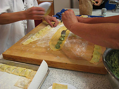 2 people's hands making ravioli