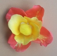peach and yellow flower made from rose petals and pom pom