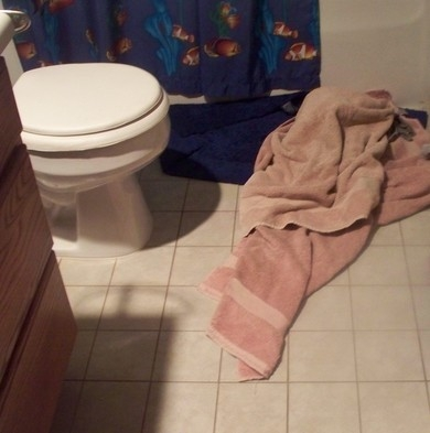 towels lying on floor in bathroom