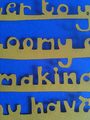 carved words in front of blue background