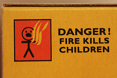 side of match box with warning 'fire kills children'