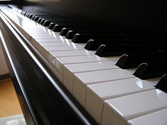 row of piano keys stretching away from camera