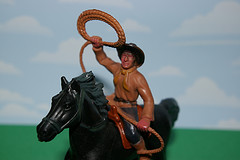 plastic cowboy on plastic horse throwing lasso