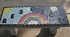 bench with rainbow and the word respect tiled on it