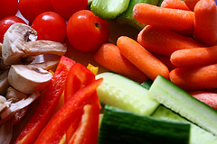 close up of colorful vegetables: carrots, peppers, tomatoes, and cucumbers