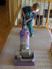 boy operating vacuum
