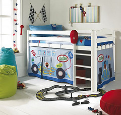 boy's room with racecar loft, toys on floor