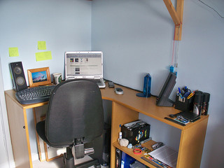 desk with computer in corner of room