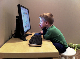 boy staring at computer screen