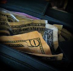 ten and one dollar bills in wallet