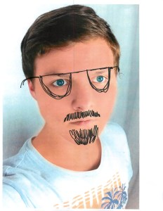 boy looking at camera, glasses and mustache drawn on face