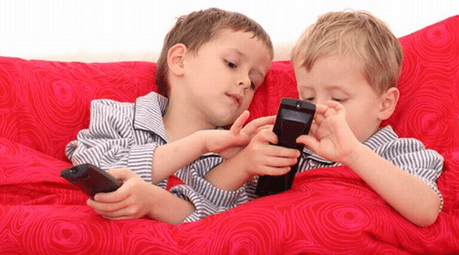 2 boys playing with cell phone