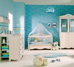 nursery with white furniture, blue walls