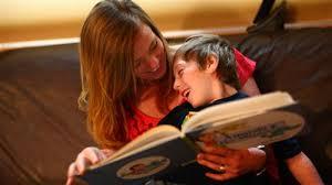 nanny reading story to little boy