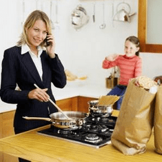 busy mom in kitchen cooking, talking on phone