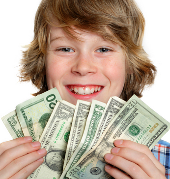 boy holding dollars fanned out