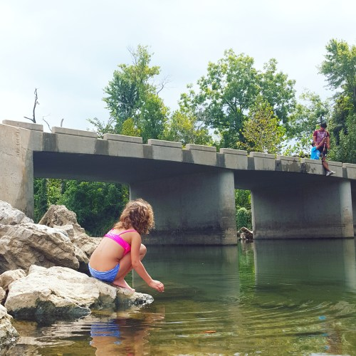 In the hotter months, this low water bridge is packed with swimmers.