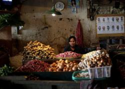 A spice vendor waits for customer at a market in Jakarta, Indonesia, Friday, Jan. 7, 2011. (Photo: AAP)