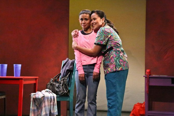 "Gaya (Nicole Barredo) is reunited with her mother Baby (Joan Almedilla) in East West Players' world production of Giovanni Ortega's ""Criers for Hire."" Photo by Michael Lamont."
