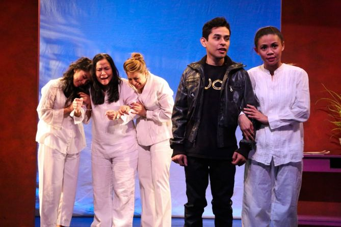 "Professional mourners Henny (Samantha Cutaran), Baby (Joan Almedilla), and Meding (Giselle ""G"" Töngi) cry in the background with Narcisco Triste (Rudy Martinez) and Gaya (Nicole Barredo) in the foreground in East West Players' world premiere comedy ""Criers for Hire"" written by Giovanni Ortega. Photo by Michael Lamont."