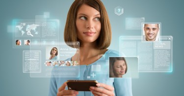Pretty modern woman using her smartphone and virtual interface to communicate. Modern technology, internet and social media concept