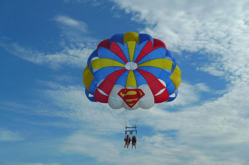 Evan and Raevian parasailing above