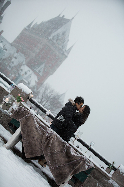 Kissing in front of Fairmont Le Chateau Frontenac