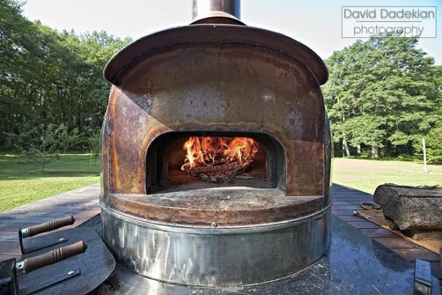 The wood burning oven on a trailer that Chef Hitz brings to Gracie's for one special dinner each year.