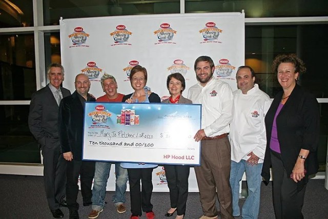 from left to right: host Billy Costa, judge David Dadekian, judge Michele Ragussis; winner Mary Jo Fletcher LaRocco, judge Peggy Poole, HP Hood Brand Manager Patrick Maguire, host Rick Tarantino and judge Cindy Salvato. Not pictured, judge Branden Lewis. Photo courtesy of Rob LaRocco